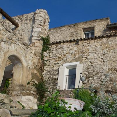 View from the garden onto the 14th century facade of Villa Velleron with olive mill